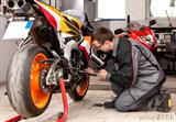 mechanic-fixing-motorcycle-engine.jpg